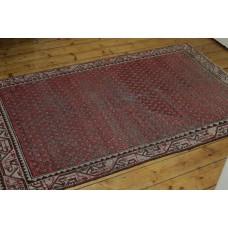 A Small Oriental Carpet