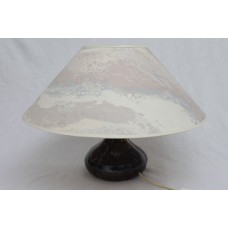 A cast lamp with 90s Shade